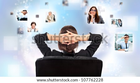 Portrait of businesswoman from behind communicating with her team across the world. International communications concept - stock photo