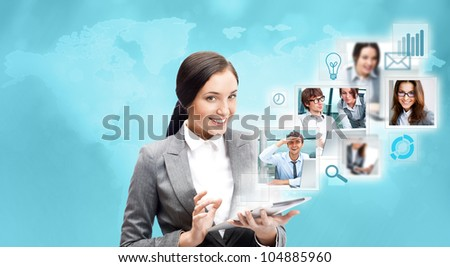 Portrait of businesswoman holding her tablet computer and communicating with her team across the world. International communications concept - stock photo