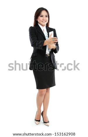 Portrait of businesswoman holding tablet computer and hand out to handshake isolated over white background - stock photo