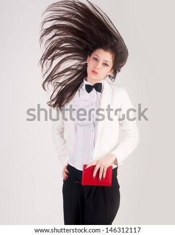 Portrait of businesswoman in white with flying hair