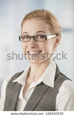 portrait of businesswoman in workplace - stock photo