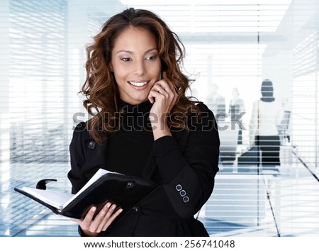 Portrait of businesswoman on the phone at office.