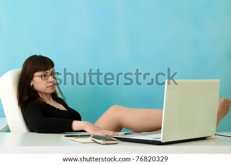 Portrait of businesswoman rests in office - stock photo