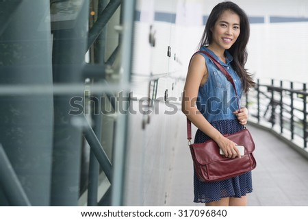 Portrait of businesswoman standing outdoor in a modern city