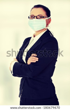 Portrait of businesswoman wearing protective mask on her face. - stock photo