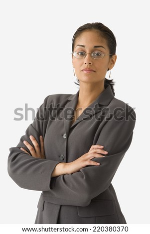 Portrait of businesswoman with arms crossed - stock photo