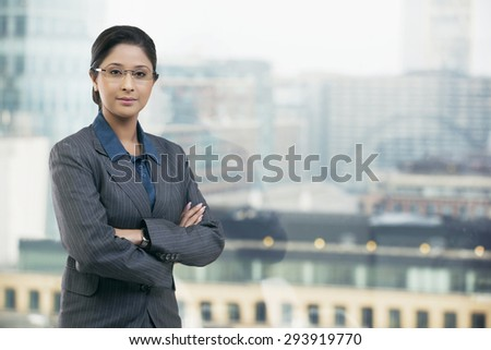 Portrait of businesswoman with arms folded - stock photo