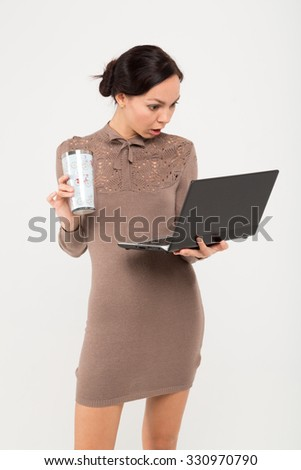 portrait of businesswoman with notebook and cup