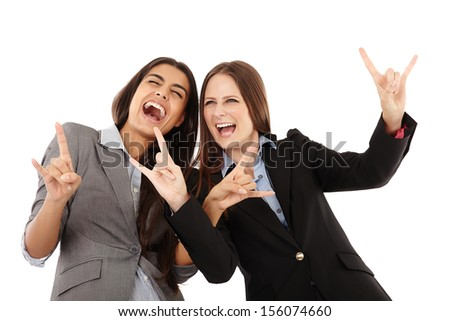 Portrait of businesswomen making a rock and roll hand gesture over white background - stock photo