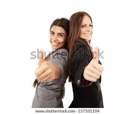Portrait of businesswomen making thumbs up sign and smiling over white background - stock photo