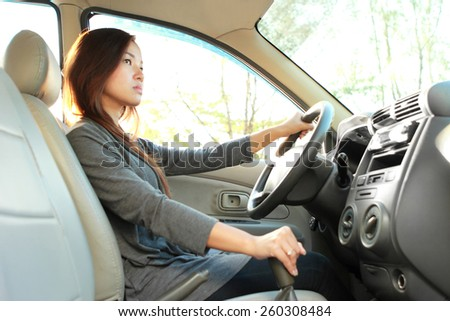 portrait of bussinesswoman driving a car - stock photo