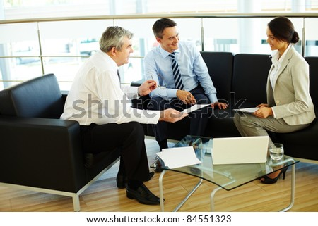 Portrait of busy people discussing new working plan at meeting - stock photo
