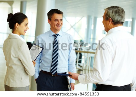 Portrait of busy people discussing new working plan or idea - stock photo