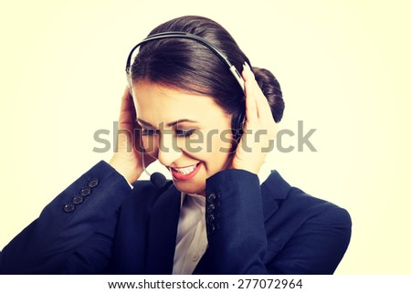 Portrait of call center woman talking to customer. - stock photo