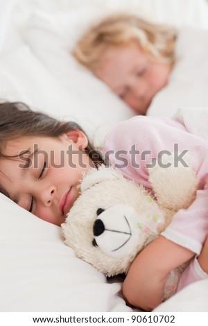 Portrait of calm children sleeping in a bedroom - stock photo