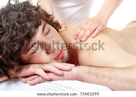 Portrait of calm guy enjoying the procedure of massage