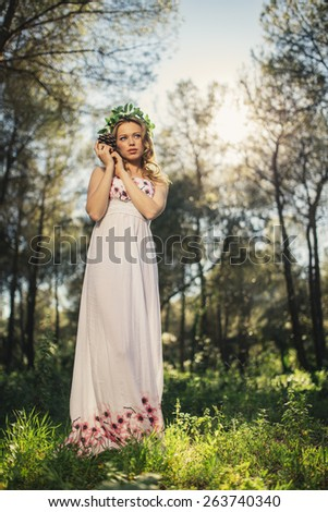 portrait of carefree young woman in white dress - stock photo