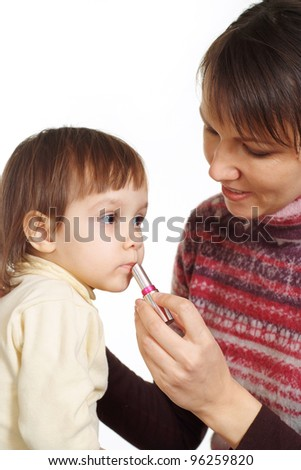 portrait of careful mother with her daughter on the white background