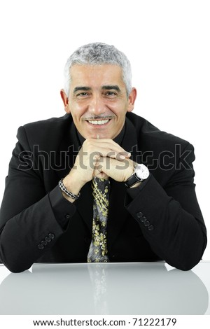 Portrait of casual businessman, sitting at desk, leaning on hands, smiling. Isolated on white.?