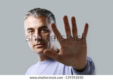 Portrait of casual man  gesturing stop