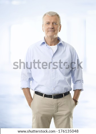 Portrait of casual senior businessman standing against white background.  - stock photo