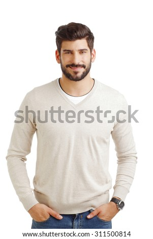 Portrait of casual young businessman standing against white background. - stock photo