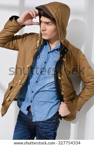 portrait of Casual young man in jacket posing - stock photo