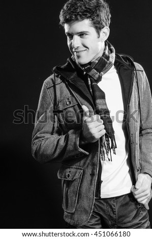 portrait of casual young man with scarf- black and white - stock photo