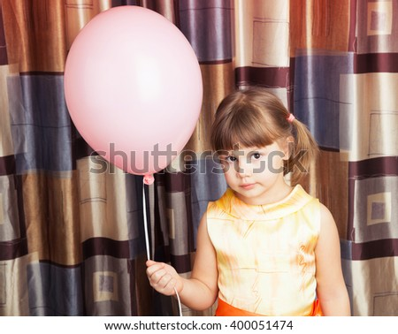 Portrait of Caucasian blond little girl with pink balloon - stock photo