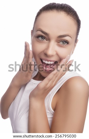 portrait of Caucasian Brunette Woman With Natural Smile and Positive Facial Expression. Isolated Over Pure White Background. Vertical Image - stock photo