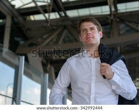 Portrait of Caucasian businessman outdoors