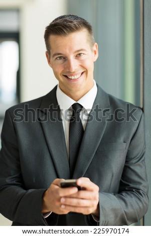 portrait of caucasian businessman using smart phone - stock photo