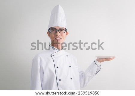 portrait of caucasian chef on white - stock photo
