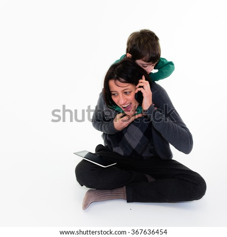 Portrait of caucasian child disturbing her mother on the phone