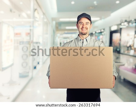 portrait of caucasian delivery man  - stock photo