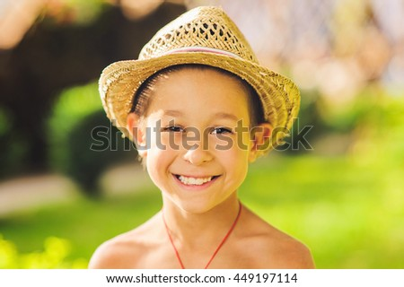 Portrait of caucasian happy baby (boy) in the hat. Child is smiling in summer day. Kid is enjoying summer. Image has copyspace for text. Outdoor, close up. - stock photo