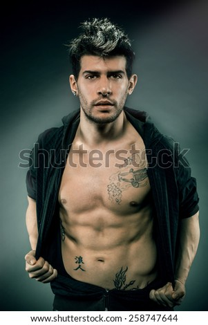 Portrait of caucasian man with great abdominal muscles - stock photo