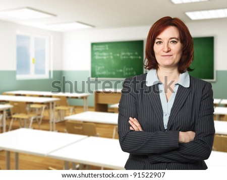 portrait of caucasian teacher and classroom background