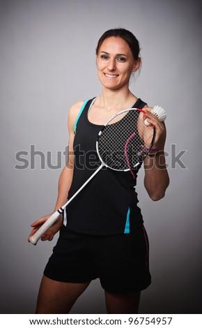 portrait of caucasian woman play badminton - stock photo