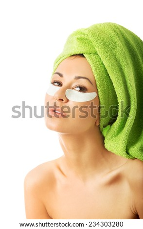 Portrait of caucasian woman with gel eye mask. - stock photo