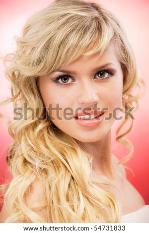 Portrait of charming blonde, on red background.