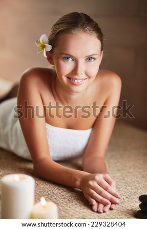 Portrait of charming female relaxing in spa salon - stock photo