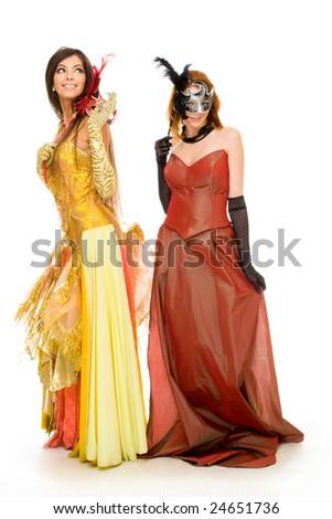 Portrait of charming females wearing elegant dresses during festival - stock photo