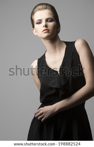 portrait of charming sensual woman with fashion elegant style posing with elegant black dress, cute hair-style and make-up  - stock photo