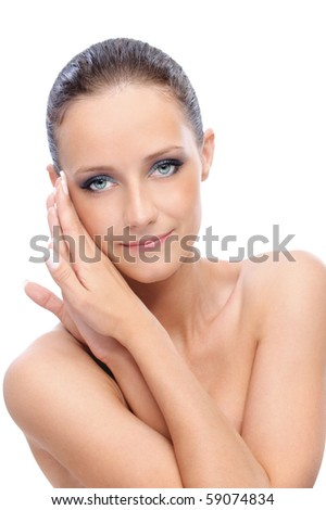Portrait of charming woman with bared shoulders, on white background.