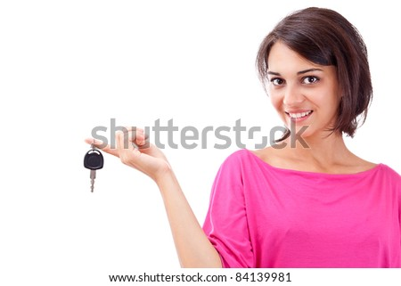 Portrait of charming young woman holding car key isolated over white background