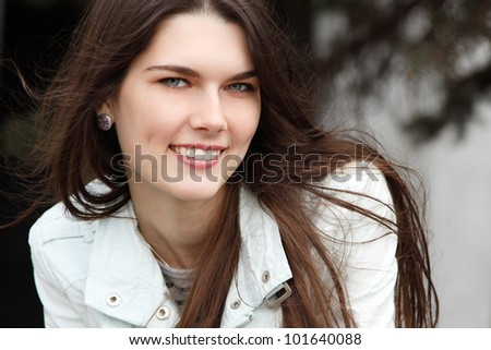 Portrait of charming young woman. Spring outdoor