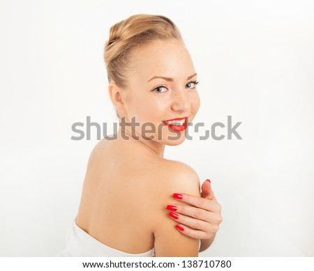 Portrait of charming young woman with red lips and manicure - stock photo
