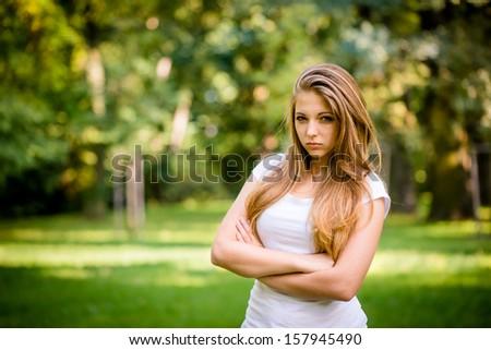 Portrait of cheeky teen girl - outdoor in nature - stock photo