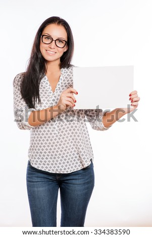 Portrait of cheerful beautiful woman showing blank signboard with copyspace area for text or slogan - stock photo